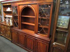 A 20th Century mahogany twin door astragal glazed cabinet,