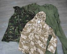 A box of miscellaneous post-war uniform including overalls together with two camo backpacks