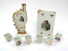 A quantity of Napoleon related ceramics including map form vessel showing battles, gilded detail,
