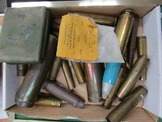 "A quantity of inert brass shell cases and rounds together with a display of ""Bullets of the World"""