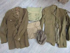A box of militaria including ATS cap and tunics