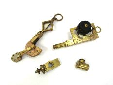 A small quantity of brass devices including Palmer folding brass clinometer (4)