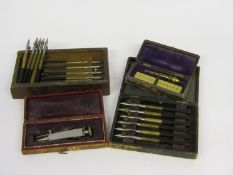 Two cases of watchmaker's jewel setting tools,