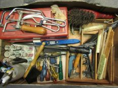 A box of mixed hand tools including screwdrivers,