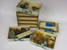 A small four drawer cabinet containing various platform escapements,
