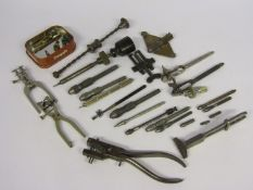 A collection of pin vices and clamps,
