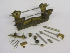A handmade brass and steel clockmaker's depthing tool with various runners etc,