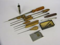 An assortment of cutting and smoothing broaches of mixed size,
