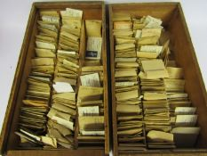 Two drawers containing a large quantity of watch balance staffs, stems,