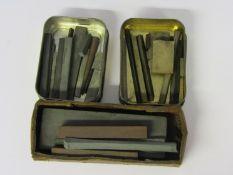 Assorted abrasive and polishing stones including Arkansas and Carborundum,