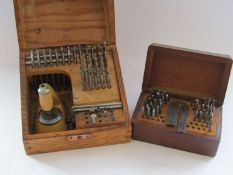 A cased staking set with assorted punches, stakes and mills (table damaged),