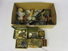 A box of mixed pocket and wristwatch movements, cases,