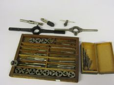 A collection of mixed size taps and dies, diestocks,