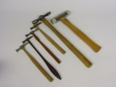 Four watchmaker's hammers including brass headed and ball pein,