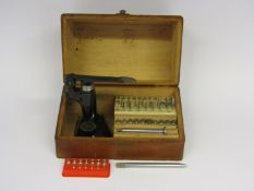 A Star jewelling set with various sized reamers and anvils,