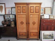 An Aesthetic period ash two door wardrobe unit with coloured parquetry decoration,