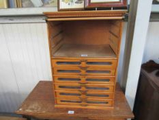 A 1950's habberdashers bank of six drawers by Tubor,