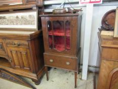 An Edwardian inlaid mahogany display cabinet with side drawer