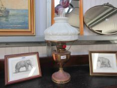 A 1920's oil lamp and shade