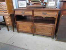 An Edwardian mahogany two drawer,