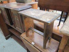 A carved oak stool