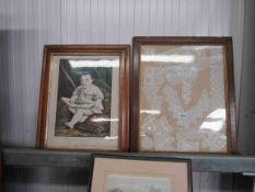 A Victorian maple framed print of the little scholar and an oak framed lace-work hall hanging