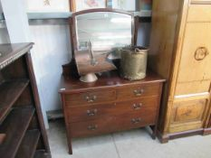 A 1930's mahogany dressing chest of four drawers