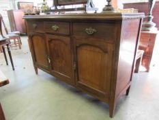 An Edwardian mahogany inlaid sideboard,