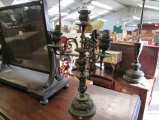 A 19th Century ornate brass four arm table lamp