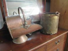 A copper coal helmet and bygone bellows and brass bucket