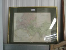 A gilt framed 19th Century map of the Known World, hand coloured by A.C.
