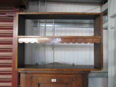 An Art Deco walnut wall shelf