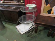 A three tier glass and metal tea trolley