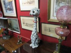"An Italian Pottery figure of a Dalmatian wearing a red bow collar. Painted ""Italy"" to base."