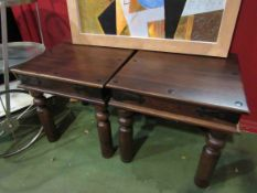 A pair of square hardwood occasional tables with metal stud embellishments,