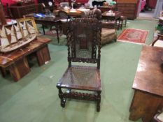 A 17th Century revival carved oak bergère chair with coronet top over barley twist supports and