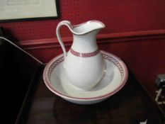 A Victorian red and white patterned wash jug and bowl