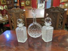 Three lidded glass decanters,