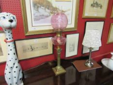 A Victorian pink oil lamp and shade, with globular shade,