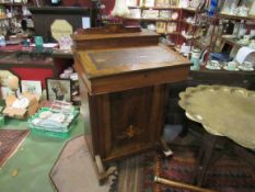 An Edwardian Davenport with cupboard to base,