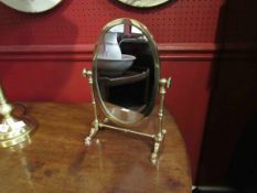 A brass dressing table swing mirror with turned supports on faceted feet (Mirror approx 27cm,