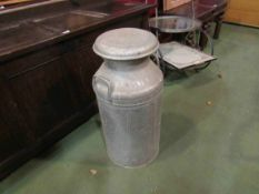 An aluminium milk churn
