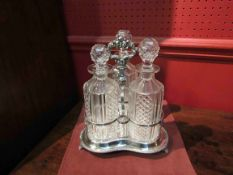 A Victorian silver plated Tantalus with three cut glass decanters