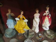 "Four Royal Doulton figurines ""Linda"" model No HN2758, ""Masquerade"" HN2259,"