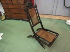 A 19th Century folding chair with carved seat and backrest having a carved coronet & Prince of