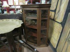 An Edwardian mahogany counter top display cabinet with painted advertising glass panels,