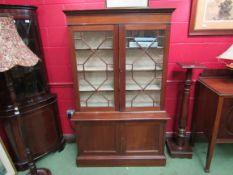 A 1930's Regency style mahogany glazed bookcase,
