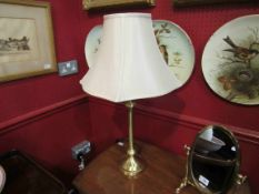 A pair of brushed brassed table lamps with shades,