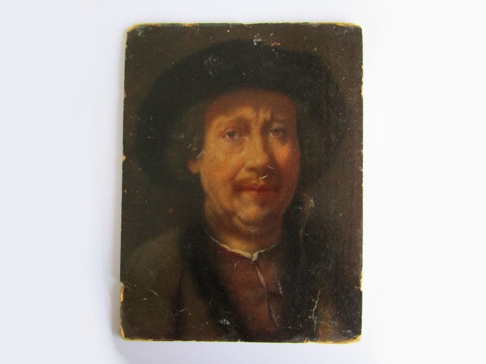 After Rembrandt : A 19thC oil on card portrait of Rembrandt wearing a fur hat and fur edged jacket.