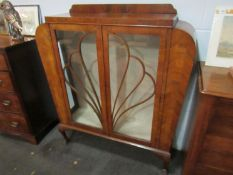 An early 20th Century walnut Deco display cabinet,